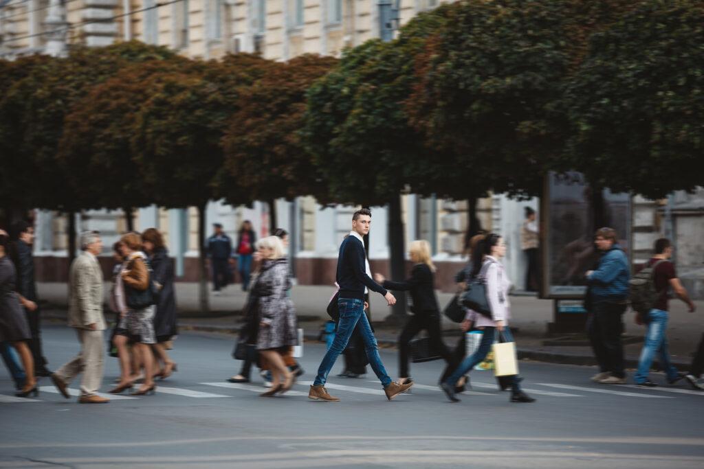 young man cross street